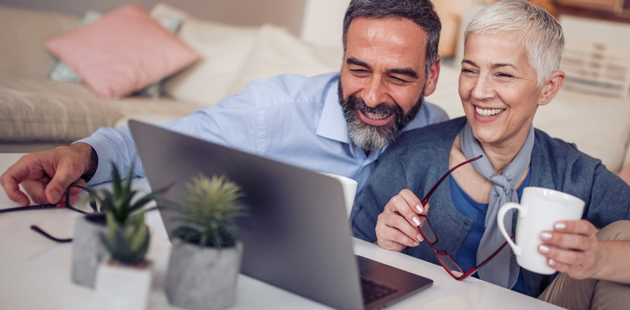 http://Older%20couple%20looking%20at%20a%20laptop