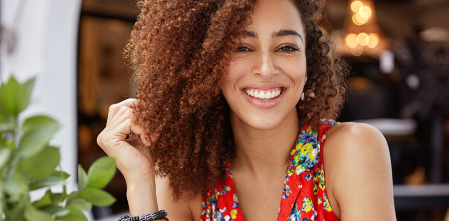 http://Portrait%20of%20a%20female%20with%20curly%20hair%20and%20no%20glasses